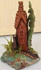 Fairy house with rock yard and pine tree