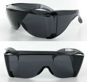 Black framed safety glasses with drak smoke lenses